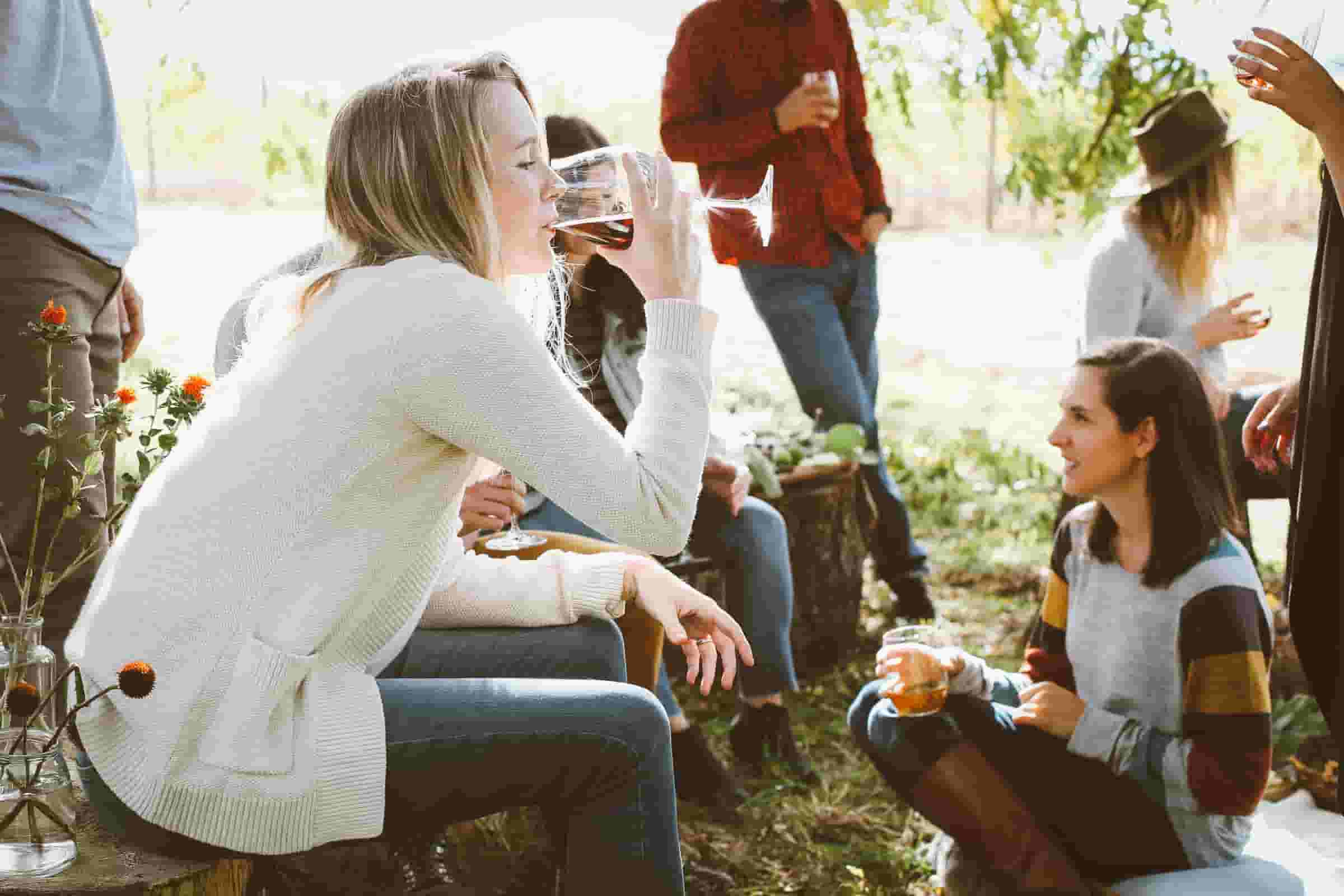 Clay pigeon shooting safety tips; A woman enjoying a glass of wine on a sunny day.