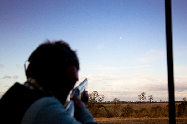 Clay Pigeon Shooting Mistakes; a person aiming at the target flying in the air