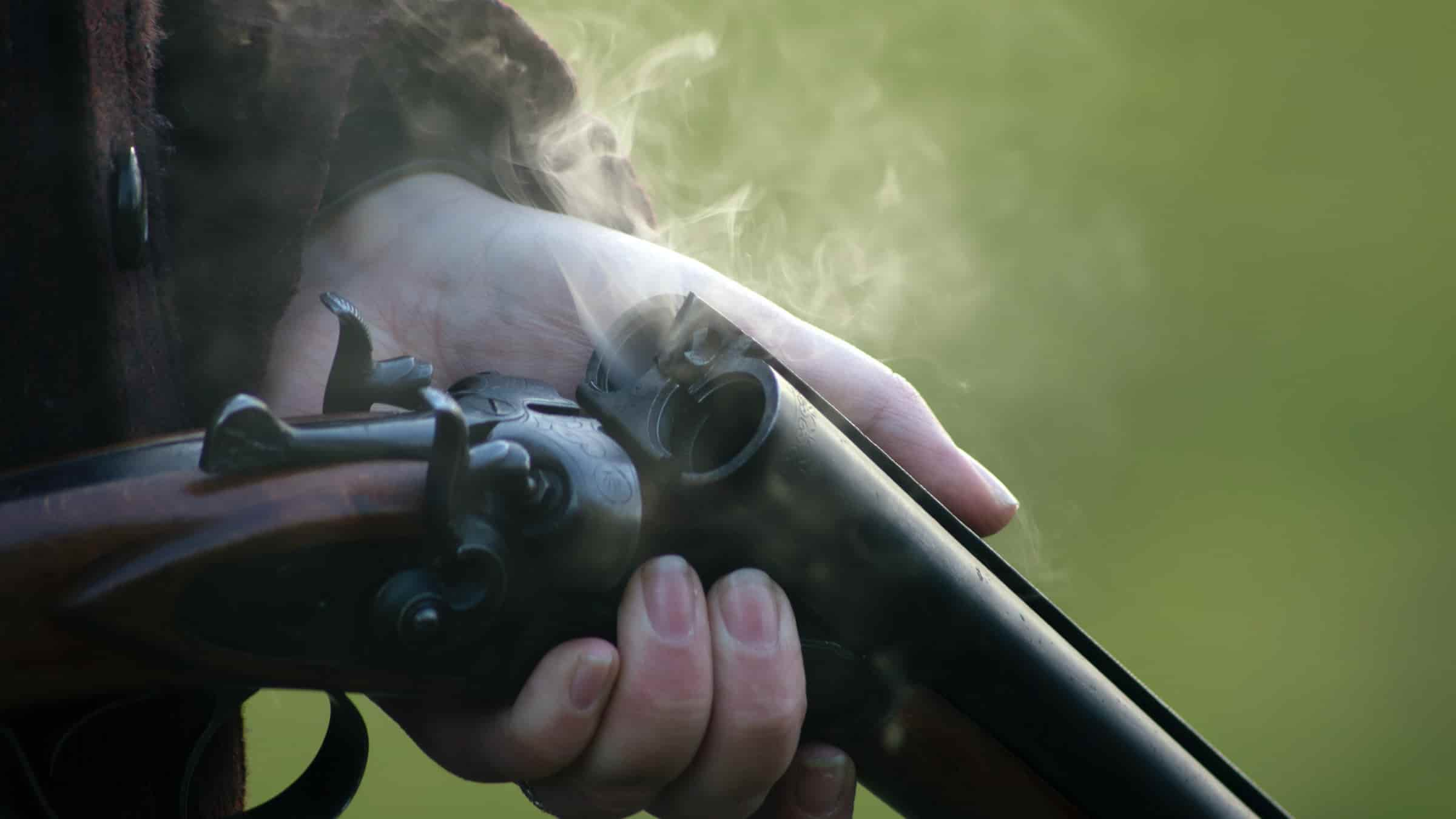 Clay pigeon shooting safety tips; smoke coming out from one part of rifle reflecting the intensity of sound while shooting.
