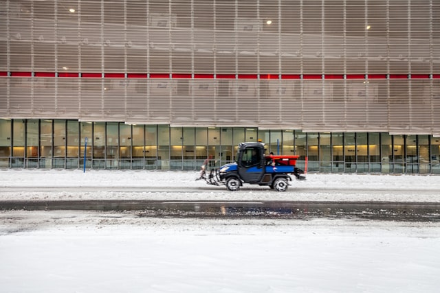 types of ATVs; a utility vehicle on a road with snow on both sides