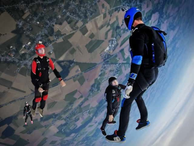 Skydivers captured in the middle of their jump from an altitude