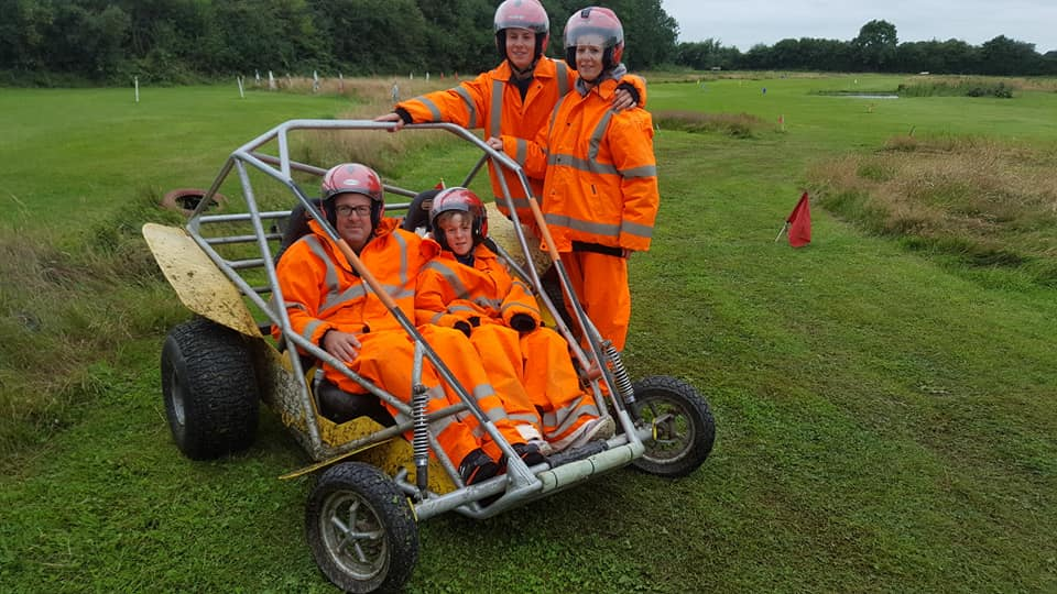 group of people driving a power turn buggy