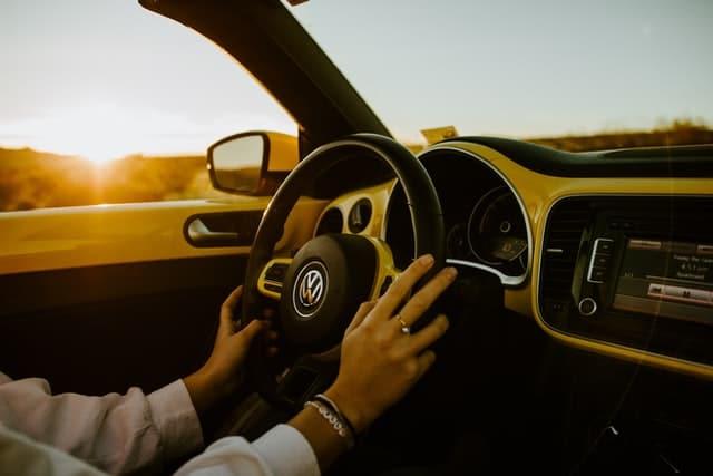 a person driving a VW car