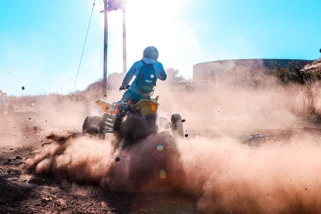 ways to reconnect with employees; a person riding an ATV