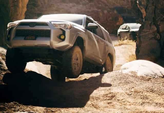 ways to reconnect with employees; a 4x4 off roading in a rocky course