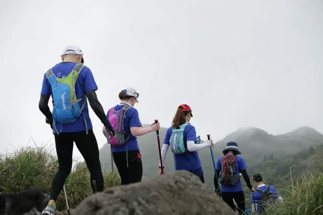 ways to reconnect with employees; a group of people in matching shirts taking a hike