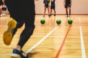 Indoor Vs Outdoor Team Building Activities; People engaged in an indoor activity.